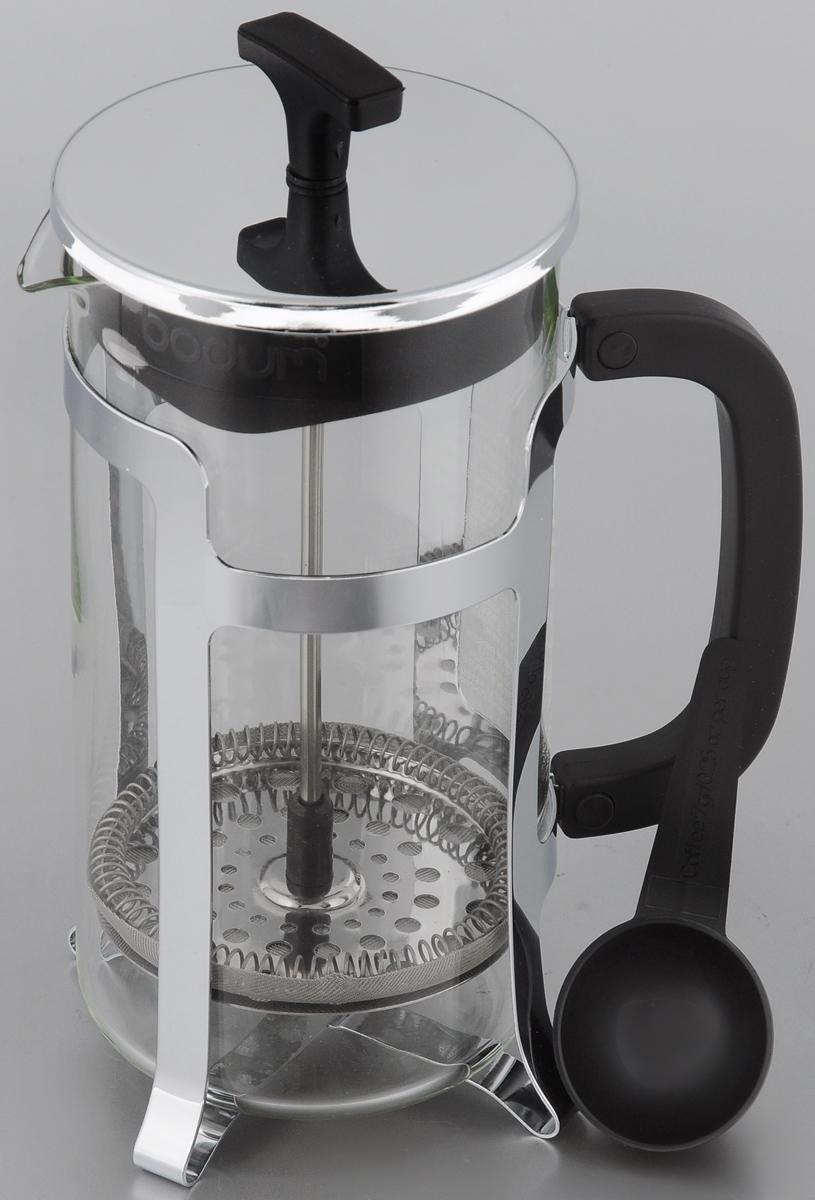 Френч-пресс Bodum Jesper, с мерной ложкой, 1 л1927-16Френч-пресс Bodum Jesper позволит быстро и просто приготовить свежий и ароматный чай или кофе. Корпус изготовлен из высококачественного жаропрочного стекла, устойчивого к окрашиванию, царапинам и термошоку. Фильтр-поршень из нержавеющей стали выполнен по технологии press-up для обеспечения равномерной циркуляции воды. Готовить напитки с помощью френч-пресса очень просто. С помощью мерной ложечки насыпьте внутрь заварку и залейте кипятком. Остановить процесс заваривания легко. Для этого нужно просто опустить поршень, и заварка уйдет вниз, оставляя вверху напиток, готовый к употреблению. Заварочный чайник с прессом - это совершенный чайник для ежедневного использования. Практичный и стильный дизайн полностью соответствует последним модным тенденциям в создании предметов кухонной утвари. Можно мыть в посудомоечной машине. Диаметр френч-пресса (по верхнему краю): 9,5 см. Высота френч-пресса (с учетом крышки): 22 см. Длина...