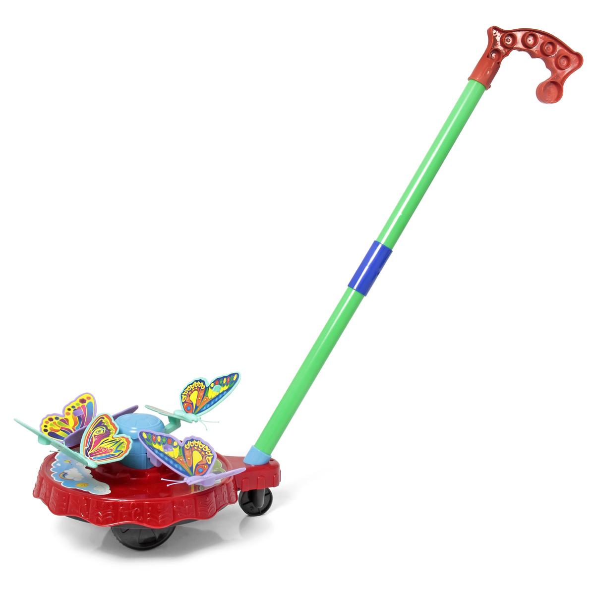Ami&Co Игрушка-каталка Бабочки44426Каталка состоит и круглой платформы, на нее устанавливаются 4 бабочки разных цветов. Палка (сборная) вставляется в платформу. Ребенок катает игрушку по полу - бабочки вращаются по кругу, поднимаясь на разный уровень. При катании игрушка издает звук колокольчика. Детская складная каталка предназначена для малышей, которые уже начали ходить самостоятельно. Яркие, забавные образы принесут радость и веселье во время игр. Гремящие, шуршащие элементы развлекут вашего малыша. Модель поможет развить координацию движения, тактильные навыки и мелкую моторику рук ребенка, а издаваемые ею звуки активно стимулируют его слух.