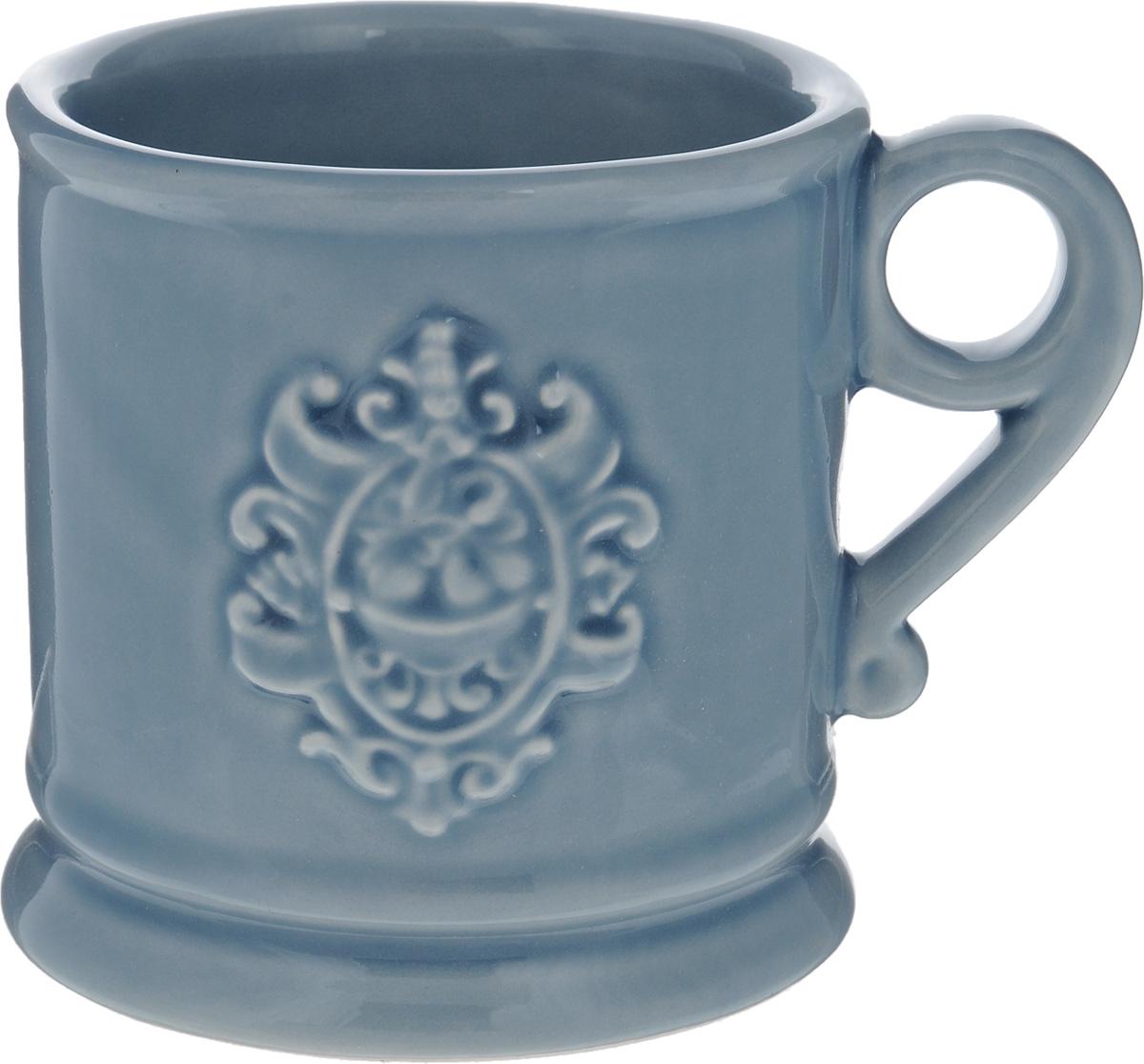 Кружка Nuova Cer Аральдо, цвет: голубой, 400 млNC8307-CRZ-ALКружка Nuova Cer Аральдо выполнена из высококачественной толстой керамики с глазурованным покрытием и оформлена оригинальным рельефным рисунком. Красивая и удобная кружка дополнит интерьер вашей кухни. Не рекомендуется мыть в посудомоечной машине и использовать в микроволновой печи. Диаметр кружки (по верхнему краю): 10 см.
