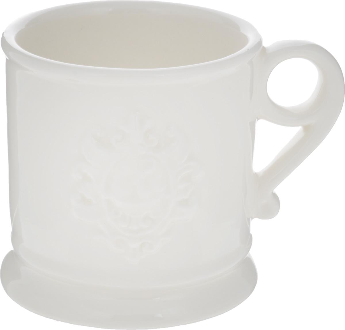 Кружка Nuova Cer Аральдо, цвет: кремовый, 400 млNC8307-AVR-ALКружка Nuova Cer Аральдо выполнена из высококачественной толстой керамики с глазурованным покрытием и оформлена оригинальным рельефным рисунком. Красивая и удобная кружка дополнит интерьер вашей кухни. Не рекомендуется мыть в посудомоечной машине и использовать в микроволновой печи. Диаметр кружки (по верхнему краю): 10 см.