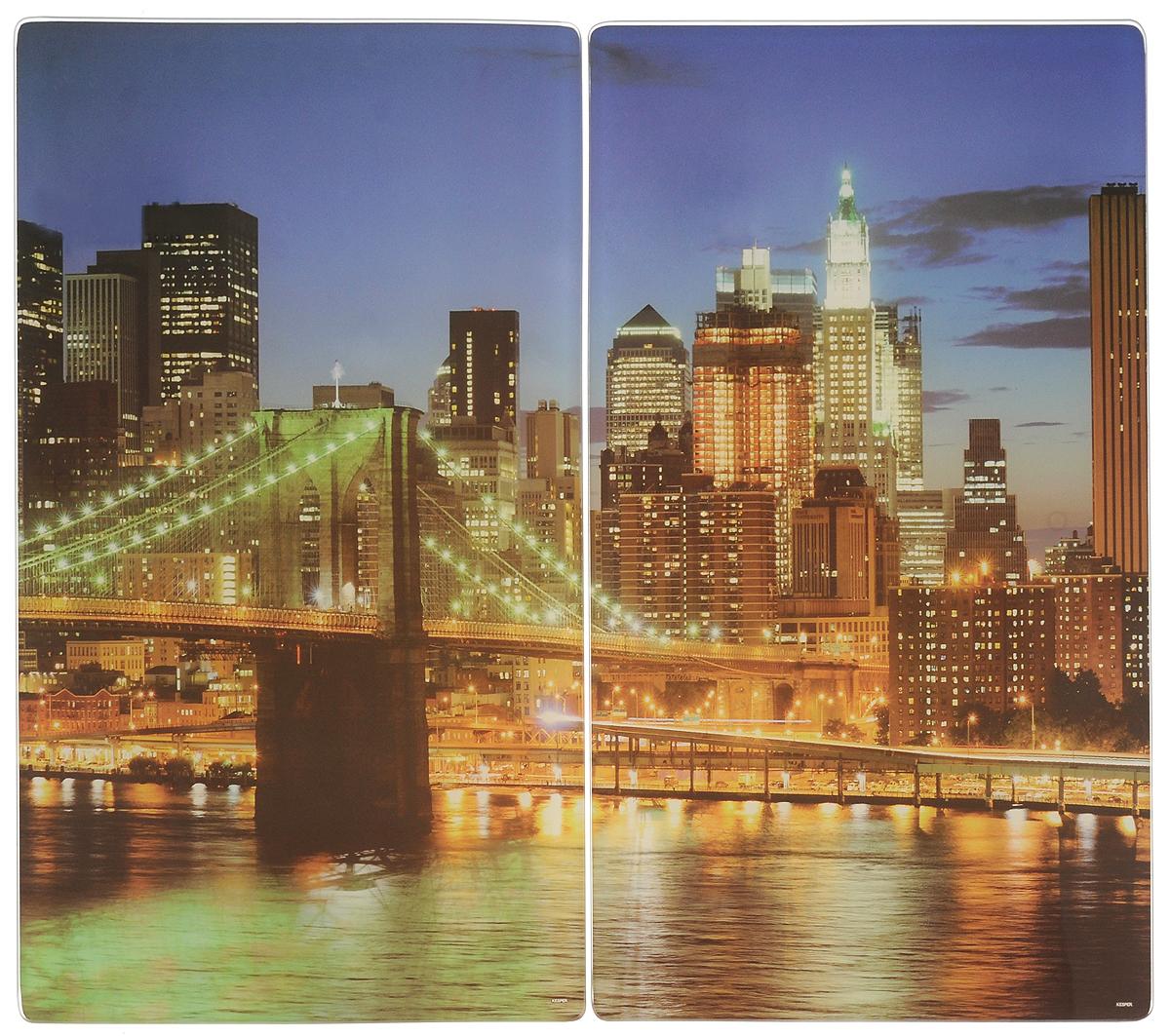 Набор разделочных досок Kesper New York, 52 х 30 см, 2 шт3652-0Набор Kesper New York состоит из двух прямоугольных разделочных досок, изготовленных из гладкого закаленного стекла с изящным изображением ночного города. Стеклянные доски устойчивы к повреждениям и не впитывают запахи, идеально подходят для разделки мяса, рыбы, приготовления теста и для нарезки любых продуктов. Доски также можно использовать как подставки под горячее, так как они выдерживают температуру до 280°C. Силиконовые ножки, расположенные на основании, не позволят разделочной доске скользить по столу. Можно мыть в посудомоечной машине.