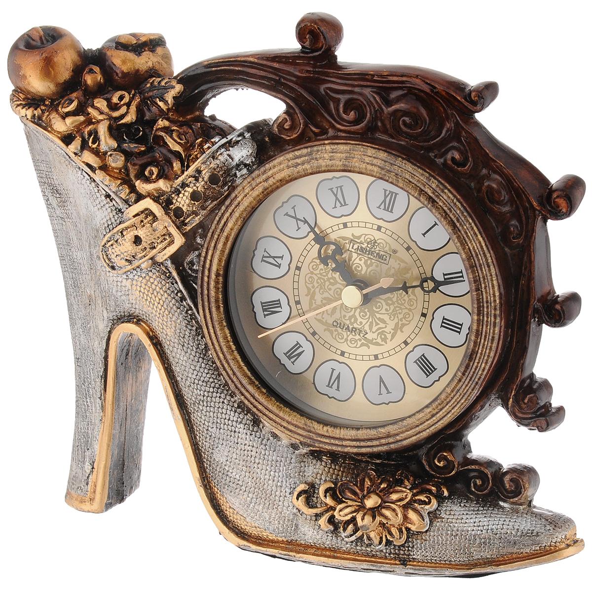 Часы настольные Lisheng Туфелька, 17,5 х 6 х 17 смLI-LS-672AM-ALНастольные кварцевые часы Lisheng Туфелька изготовлены из полистоуна бронзового цвета. Изделие выполнено в виде туфельки. Циферблат круглой формы расположен на туфельке и оформлен римскими цифрами. Настольные часы Lisheng Туфелька прекрасно оформят интерьер дома или рабочий стол в офисе. Часы работают от одной батарейки типа АА мощностью 1,5V (не входит в комплект). Размер часов: 17,5 х 6 х 17 см. Диаметр циферблата: 8 см.