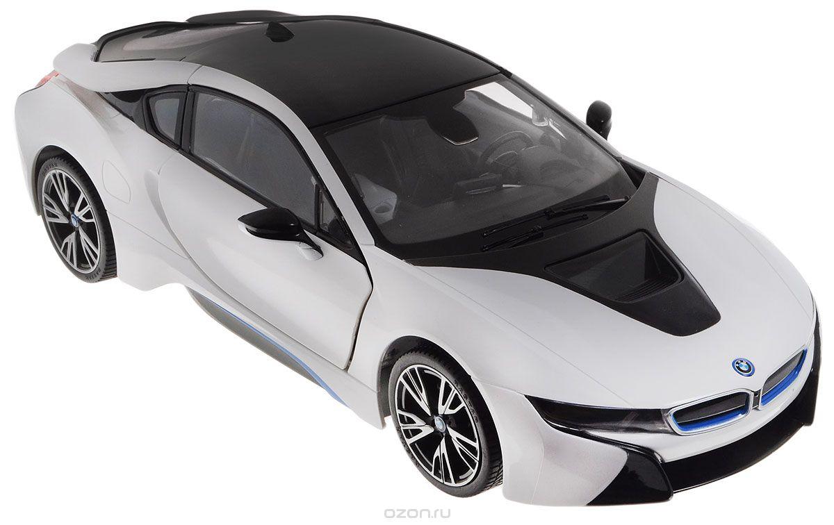 Rastar Радиоуправляемая модель BMW i8 цвет белый черный масштаб 1:1471000Радиоуправляемая модель Rastar BMW i8 станет отличным подарком любому мальчику! Все дети хотят иметь в наборе своих игрушек ослепительные, невероятные и крутые автомобили на радиоуправлении. Тем более, если это автомобиль известной марки с проработкой всех деталей, удивляющий приятным качеством и видом. Одной из таких моделей является автомобиль на радиоуправлении Rastar BMW I8. Это точная копия настоящего авто в масштабе 1:14. Авто обладает неповторимым провокационным стилем и спортивным характером. Потрясающая маневренность, динамика и покладистость - отличительные качества этой модели. Корпус автомобиля выполнен из металла с использованием пластиковых элементов. Возможные движения: вперед, назад, вправо, влево, остановка. Колеса игрушки прорезинены и обеспечивают плавный ход, машинка не портит напольное покрытие. Имеются световые эффекты, а также открывание дверей происходит дистанционно с пульта управления. Пульт управления работает на...