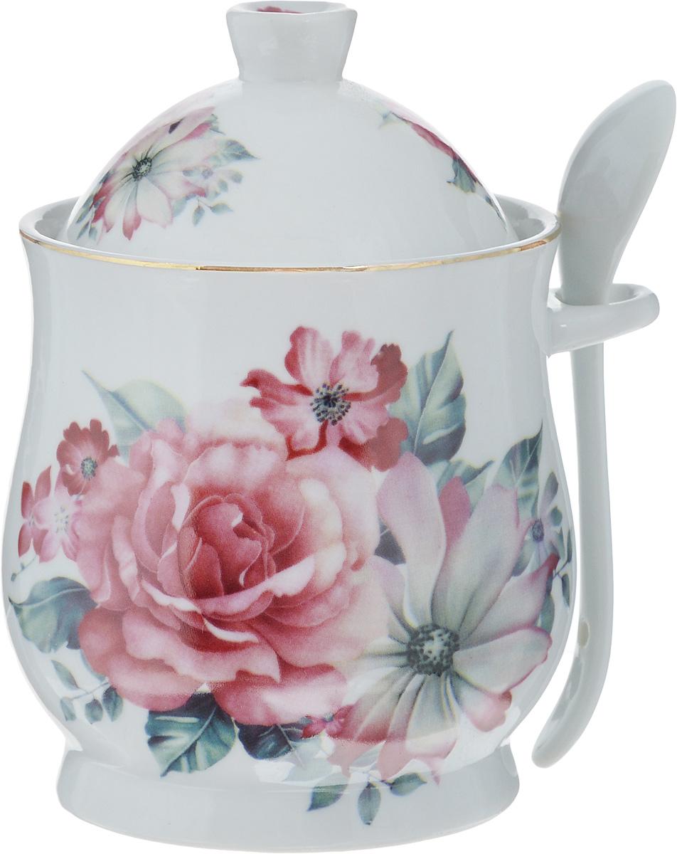 Сахарница Loraine Розы, с ложкой, 300 мл24601Сахарница Loraine с крышкой и ложкой изготовлена из высококачественной керамики и украшена цветочным рисунком. На корпусе предусмотрена специальная петелька для хранения ложки. Яркий дизайн, эстетичность и функциональность сахарницы делают ее незаменимой на любой кухне. Сахарница упакована в подарочную коробку. Диаметр сахарницы (по верхнему краю): 8 см. Диаметр основания: 7 см. Высота сахарницы (без учета крышки): 9 см. Высота сахарницы (с учетом крышки): 13 см. Длина ложки: 11,5 см.