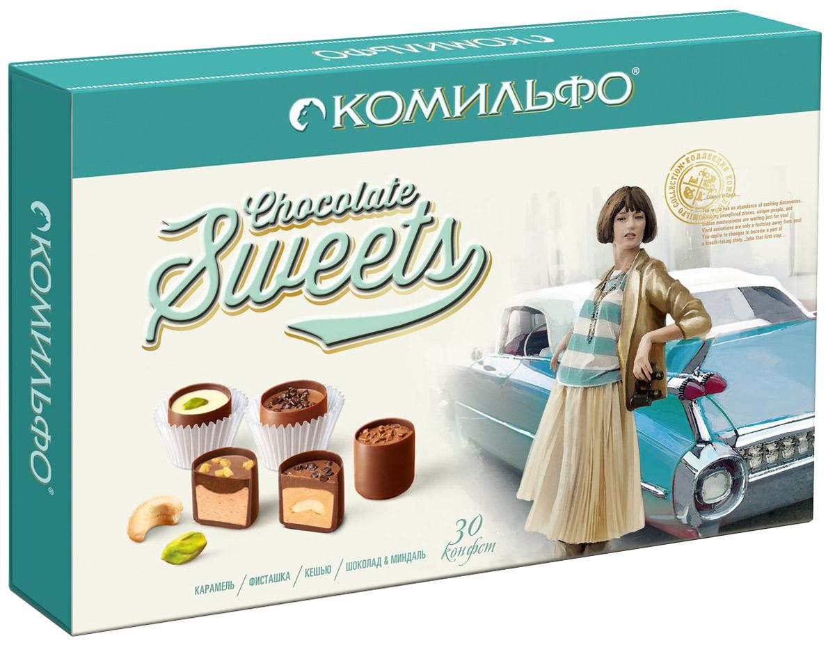 Комильфо шоколадные конфеты ассорти, 348 г12287035Каждая конфета Комильфо - это неповторимое сочетание нежной текстуры, нескольких восхитительных начинок в обрамлении превосходного шоколада и акцента в виде изысканного украшения. Уникальные конфеты словно изготовлены вручную и упакованы в премиальную, женственную, подарочную коробку. Прекрасный подарок для ваших близких. В наборе четыре вида конфет - кешью, карамель, фисташка, шоколад и миндаль. Уважаемые клиенты! Обращаем ваше внимание, что полный перечень состава продукта представлен на дополнительном изображении.