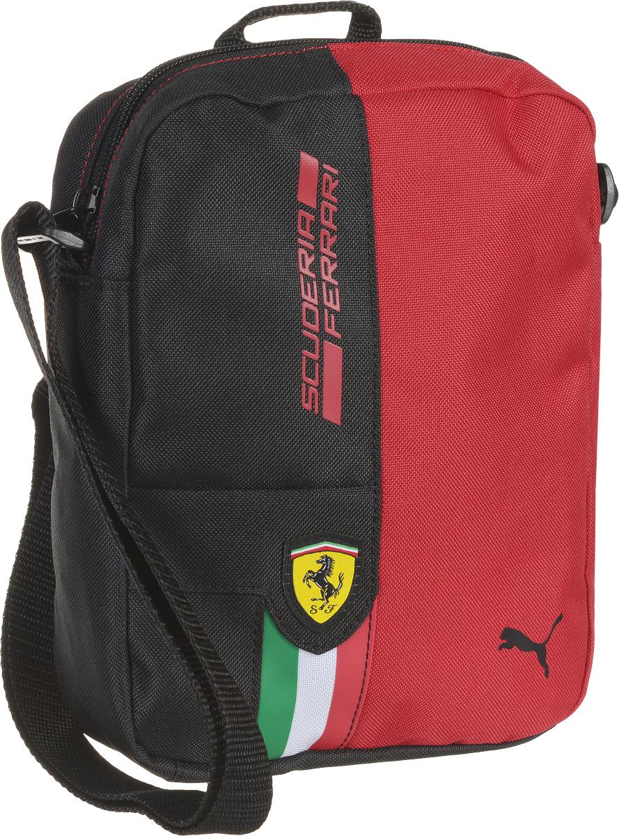 Сумка на плечо Puma Ferrari Fanwear Portable, цвет: красный, черный. 0742750107427501Сумка от Puma серии Ferrari Fanwear Portable выполнена из текстиля. Модель декорирована фирменной символикой Puma на металлических язычках застежек-молний, тканой эмблемой Ferrari спереди, набивным логотипом гоночной команды Ferrari контрастного цвета спереди, изображением итальянского флага спереди и, кроме того, логотипом Puma, который также нанесен на переднюю часть изделия. Сумка выделяется особой практичностью, имеет главное отделение на молнии, два внутренних накладных кармана, функциональную подкладку из полиэстера с изнанкой из полиуретана, ручку для переноски и лямку через плечо регулируемой длины из лямочной ленты. Сумка украшена пластиковой фурнитурой Duraflex. Сумка Ferrari Fanwear Portable - городская функциональная сумка, которая станет удобным и эргономичным аксессуаром для современного жителя мегаполиса, предпочитающего активный образ жизни и любящего спорт. Станьте частью легендарной семьи Scuderia Ferrari, ощутите комфорт вместе с этой стильной...
