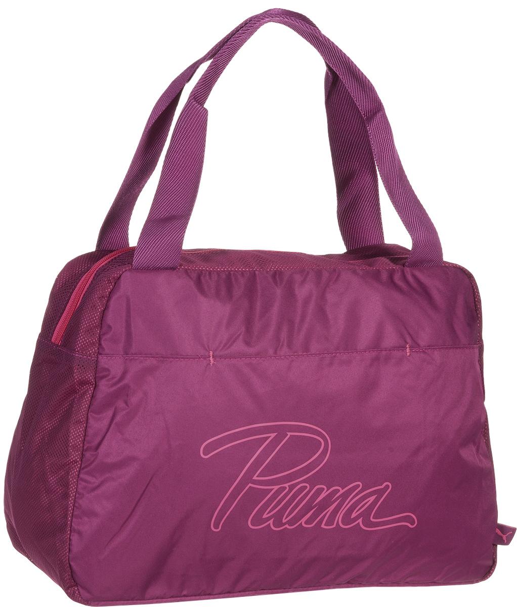 Сумка женская Puma Core Grip Bag, цвет: фуксия. 0737960507379605Сумка PUMA Core Grip Bag - удобная сумка для небольших путешествий, прогулок или работы. В ее вместительном основном отделении вы сможете хранить все нужные вам вещи, а в специальный внутренний карман для мелочей положить ключи и мобильный телефон, чтобы не искать их среди прочих вещей. Главное отделение на молнии открывается с двух сторон. Изделие оснащено накладным карманом спереди, карманом на молнии и накладным карманом внутри главного отделения, а также функциональной подкладкой из полиэстера с изнанкой из полиуретана. Строгий и стильный дизайн этой сумки дополнен логотипом Puma. Удобные ручки из ткани обладают высокой прочностью, а дно сумки держит форму. Основанный в 1948 году бренд Puma стал выбором многих героев мирового спорта. Дизайн Puma сосредоточен на стиле и функциональности моделей, поэтому коллекции брендовой одежды и обуви сочетают современный стиль с инновационными спортивными технологиями.