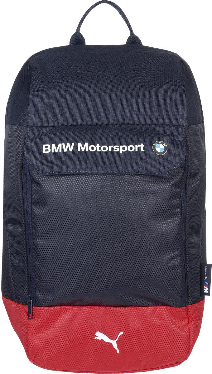 Рюкзак городской Puma BMW Motorsport Backpack, цвет: синий. 0742690207426902Стильный рюкзак от Puma линии BMW Автоспорт создан для любителей активного образа жизни. Модель выполнена из полиэстера и декорирована набивной надписью BMW и набивной эмблемой BMW спереди, тканым ярлыком сбоку с текстом powered by M и набивным логотипом Puma спереди. Декоративные элементы также представлены яркими прорезиненными шнурами, продернутыми сквозь язычки застежек-молний и пластиковой фурнитурой Duraflex. Рюкзак имеет главное отделение на молнии, открывающейся с двух сторон, внутреннее отделение для ноутбука с мягкой подложкой из эластичного материала, отделение спереди на молнии под клапаном на липучке и внутренние накладные карманы для электронных устройств. Изделие оснащено функциональной подкладкой из полиэстера с изнанкой из полиуретана, закруглёнными лямками через плечо регулируемой длины с мягкой подложкой и ручкой для переноски из лямочной ленты. Основанный в 1948 году бренд Puma стал выбором многих героев мирового спорта. Дизайн Puma...