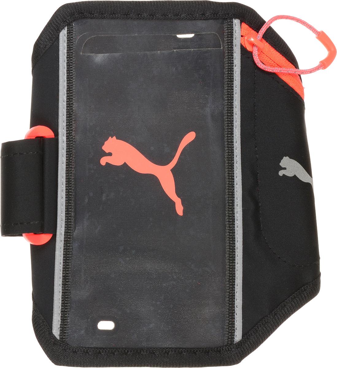 Сумка/чехол для мобильных устройств Puma PR I Sport Phone Armband, цвет: черный. 05305606. Размер L/XL05305606_черный_L/XLНарукавная сумочка для бегуна имеет прозрачное «окошко» под размер экрана I-Phone 6, позволяющее осуществлять сенсорное управление электронным устройством, а также дополнительное отделение на молнии для ключей и мелких предметов. Сумочка украшена спереди цветным набивным логотипом Puma, а сбоку - логотипом Puma из светоотражающего материала для повышения вашей безопасности в темное время суток. Сумочка надежно крепится к руке при помощи эластичного держателя регулируемой длины с пластиковой фурнитурой и выпускается двух размеров: S/M (на окружность бицепса 24-29 см) и L/XL (на окружность бицепса 30-38 см).