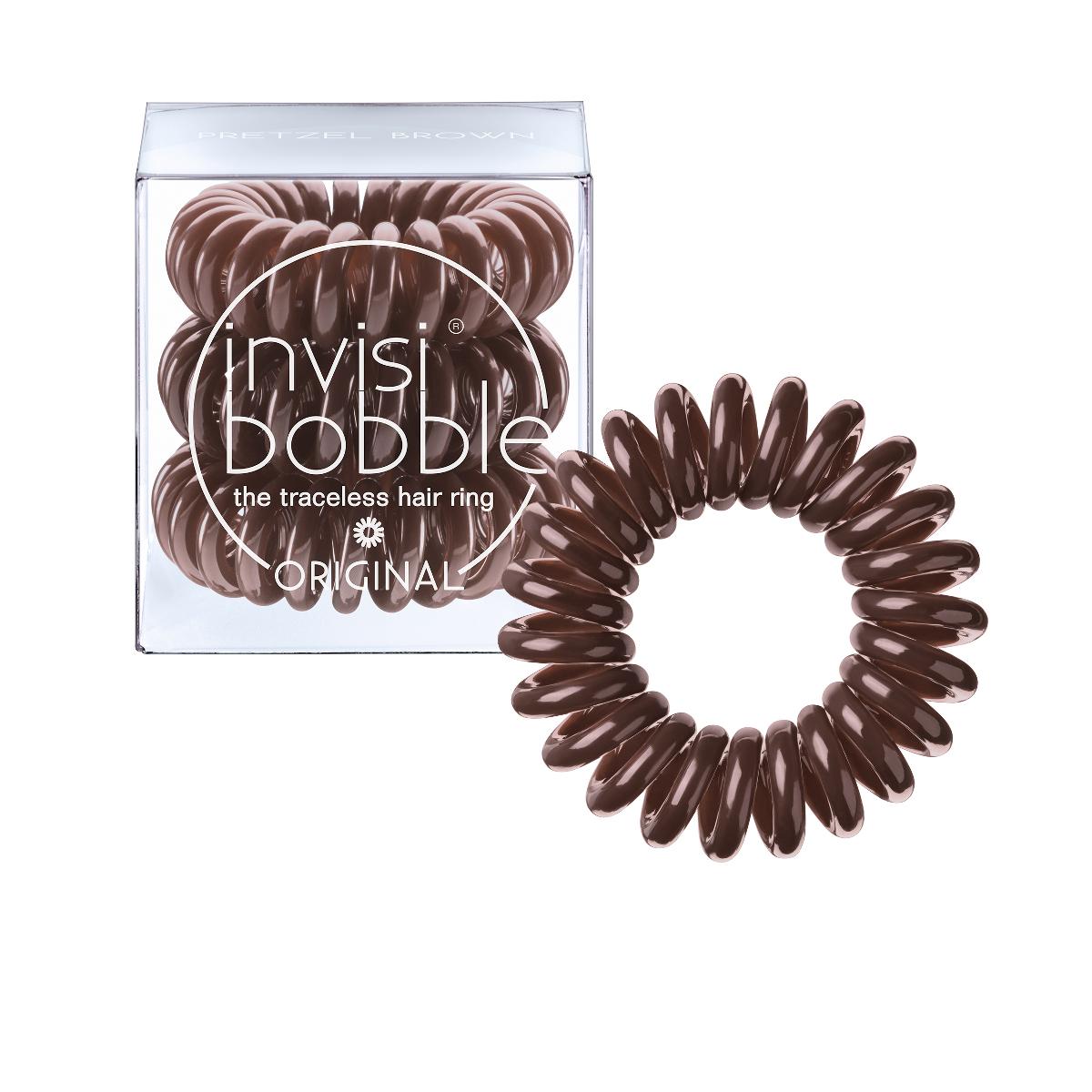 Invisibobble Резинка-браслет для волос Original Pretzel Brown3041Оттенок invsibobble pretzel brown из коллекции ORIGINAL идеально подойдет для темноволосых девушек и позволит создать безупречный образ! В коллекцию ORIGINAL вошли наиболее популярные цвета резинок-браслетов, а также новые цвета для создания безупречного образа на каждый день. Резинки-браслеты invisibobble подходят для всех типов волос, надежно фиксируют причёску, не оставляют заломов и не вызывают головную боль благодаря неравномерному распределению давления на волосы. Кроме того, они не намокают и не вызывают аллергию при контакте с кожей, поскольку изготовлены из искусственной смолы.