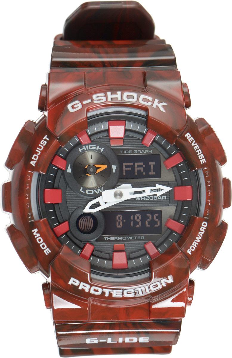 Часы наручные мужские Casio G-Shock, цвет: красный, черный. GAX-100MB-4AGAX-100MB-4AУдаропрочные часы G-Shock от Casio и, в соответствии с морской концепцией, отображают высоту приливов/отливов и лунные фазы. Двойная цифро-аналоговая индикация и встроенный датчик температуры - эти часы определенно подойдут любителям экстремальных видов спорта. Ударопрочная конструкция защищает механизм от ударов и вибрации. Изделие защищено от магнитных полей. Комбинированный корпус выполнен из нержавеющей стали 316L и композитного полимерного материала, оснащен минеральным стеклом, устойчивым к возникновению царапин. Ремешок также выполнен из полимерного материала и оснащен надежной классической застежкой с двойным шипом. Циферблат подсвечивается светодиодом, а умная и приятная функция автоподсветки освещает циферблат при повороте часов к лицу. Помимо этого стоит отметить еще люминесцентный состав на стрелках и часовых метках с ярким послесвечением даже после кратковременного воздействия света. Часы оснащены кварцевым механизмом с двойной...