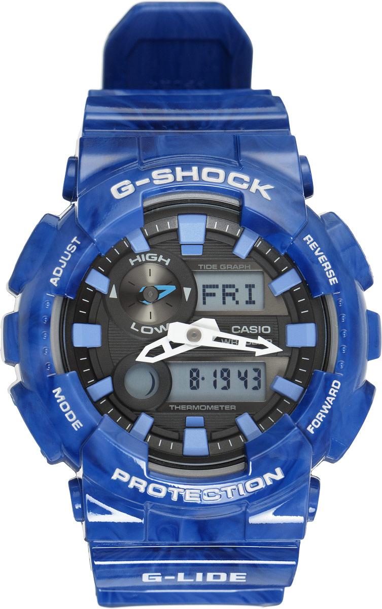 Часы наручные мужские Casio G-Shock, цвет: синий, черный. GAX-100MA-2AGAX-100MA-2AУдаропрочные часы G-Lide имеют все свойства и преимущества знаменитых G-Shock от Casio и, в соответствии с морской концепцией, отображают высоту приливов/отливов и лунные фазы. Двойная цифро-аналоговая индикация и встроенный датчик температуры - эти часы определенно подойдут любителям экстремальных видов спорта. Ударопрочная конструкция защищает механизм от ударов и вибрации. Изделие защищено от магнитных полей. Комбинированный корпус выполнен из нержавеющей стали 316L и композитного полимерного материала, оснащен минеральным стеклом, устойчивым к возникновению царапин. Ремешок также выполнен из полимерного материала и оснащен надежной классической застежкой с двойным шипом. Циферблат подсвечивается светодиодом, а умная и приятная функция автоподсветки освещает циферблат при повороте часов к лицу. Помимо этого стоит отметить еще люминесцентный состав на стрелках и часовых метках с ярким послесвечением даже после кратковременного воздействия света. Часы...