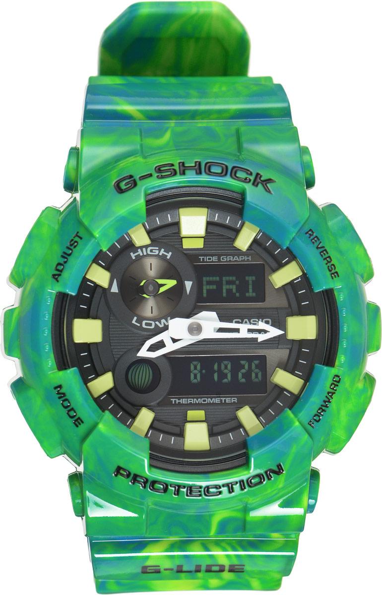 Часы наручные мужские Casio G-Shock, цвет: зеленый, черный. GAX-100MB-3AGAX-100MB-3AУдаропрочные часы G-Shock от Casio в соответствии с морской концепцией, отображают высоту приливов/отливов и лунные фазы. Двойная цифро-аналоговая индикация и встроенный датчик температуры - эти часы определенно подойдут любителям экстремальных видов спорта. Ударопрочная конструкция защищает механизм от ударов и вибрации. Изделие защищено от магнитных полей. Комбинированный корпус выполнен из нержавеющей стали 316L и композитного полимерного материала, оснащен минеральным стеклом, устойчивым к возникновению царапин. Ремешок также выполнен из полимерного материала и оснащен надежной классической застежкой с двойным шипом. Циферблат подсвечивается светодиодом, а умная и приятная функция автоподсветки освещает циферблат при повороте часов к лицу. Помимо этого стоит отметить еще люминесцентный состав на стрелках и часовых метках с ярким послесвечением даже после кратковременного воздействия света. Часы оснащены кварцевым механизмом с двойной цифро-аналоговой...