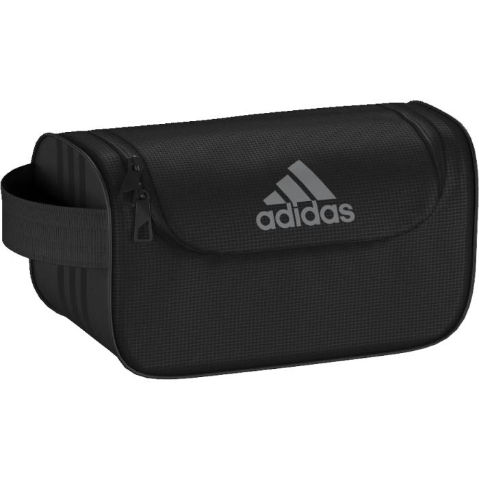 Косметичка Adidas, цвет: черный. AK0021AK0021Стильная косметичка для туалетных принадлежностей. Спортивная косметичка для удобного хранения принадлежностей для душа и предметов личной гигиены. Основное отделение на молнии; внутренний карман на молнии Боковая ручка Тональные три полоски сбоку Логотип adidas на лицевой стороне Размеры: 13 см х 13 см х 26 см