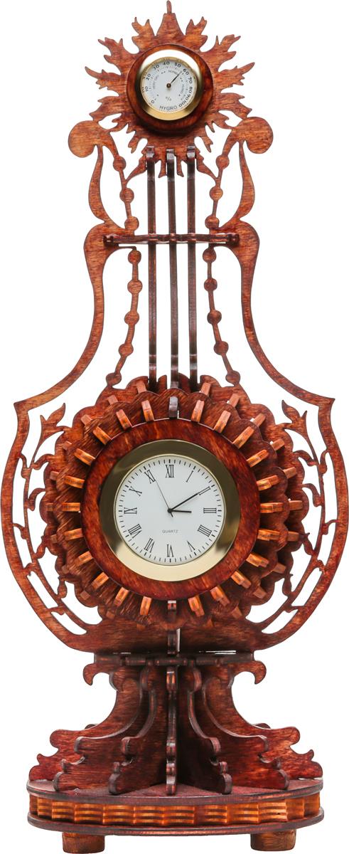Часы настольные Французская Лира с гигрометром. Фанера, тонирование. Россияnikch30Часы настольные Французская Лира с гигрометром, стилизованные под струнный щипковый музыкальный инструмент. Выполнены часы из 4 мм фанеры и затонированы под красное дерево. Размеры: - высота - 39 см; - корпус - 17 х 9,5 см. Функционал состоит из двух частей: - основной - часовая капсула, диаметр - 6,5 см; - дополнительный вверху - гигрометр либо термометр, диаметр - 3,3 см. Часовая капсула работает от батарейки. В случае остановки часового механизма капсула легко вынимается для замены элемента питания. Часы могут послужить отличным дополнением интерьера вашей квартиры или офиса.