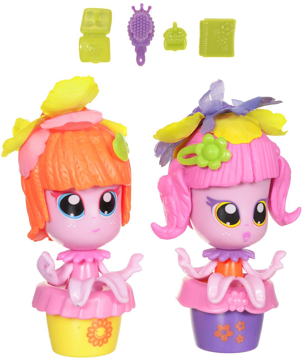 Daisy Игровой набор с мини-куклами Цветочек цвет розовый оранжевый 2 шт29510_розовый/оранжевыйМини-куклы Daisy Цветочки - это разноцветные разборные игрушки, которые могут меняться между собой прическами, цветочными шляпками и аксессуарами. Игрушки выполнены в виде куколок в цветочном горшочке. У куколок огромные нарисованные глазки, ручки-лепестки и съемные прически. Прически куколок украшены съемными текстильными шляпками в виде цветочков. Дополняют модный образ кукол стильные аксессуары. Можно выбрать комплект кукол с аксессуарами, со сказочным питомцем, или даже c домом-лейкой и мини-мебелью (каждый продается отдельно). Куколки-цветочки можно наряжать, меняя их образы, брать с собой в дорогу или в гости! Соберите коллекцию и подружите куколок между собой! В комплекте две мини-куклы. Мини-куклы Daisy Цветочек ароматизированы.