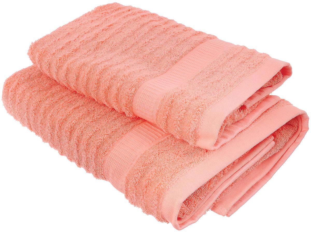 Набор хлопковых полотенец Home Textile, цвет: коралловый, 2 штLX-OZ16Набор Home Textile состоит из двух полотенец разного размера, выполненных из качественной натуральной махры (100% хлопок). Полотенца имеют ворс различной длины, что создает рельефную текстуру и классический бордюр. Мягкие и уютные, они прекрасно впитывают влагу и легко стираются. Кроме того, хлопковые полотенца отличаются высокой износоустойчивостью и долгим сроком службы. Такой набор полотенец подарит массу положительных эмоций и приятных ощущений. Размер полотенец: 50 х 90 см, 70 х 140 см.