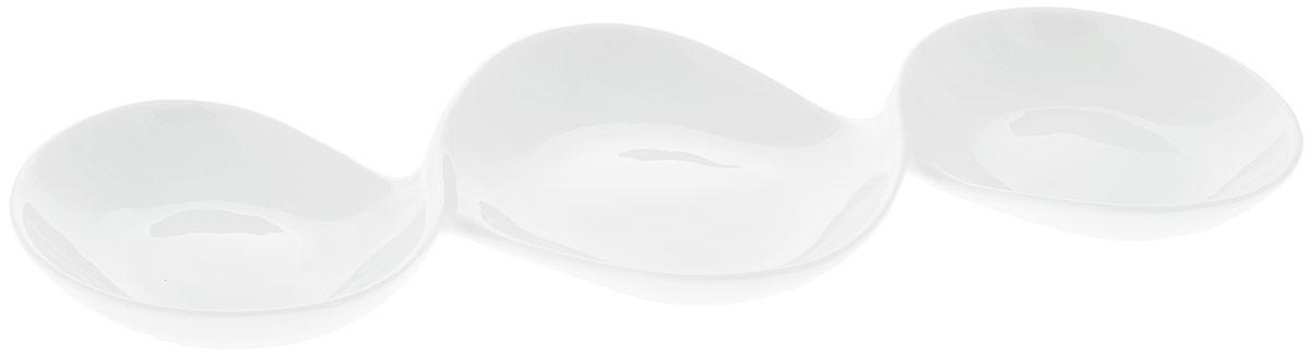 Менажница Wilmax, 3 секции, 37 х 17 смWL-992416 / AМенажница Wilmax изготовлена из высококачественного фарфора с глазурованным покрытием. Материал легкий, тонкий, свет без труда проникает сквозь изделие. Посуда имеет роскошную белизну, гладкость и блеск достигаются за счет особой рецептуры глазури. Изделие обладает низкой водопоглощаемостью, высокой термостойкостью и ударопрочностью, а также экологичностью. Посуда долговечна и рассчитана на постоянное интенсивное использование. Гладкая непористая поверхность исключает проникновение бактерий, изделие не будет впитывать посторонние запахи и сохранит первоначальный цвет. Менажница прекрасно подойдет для подачи различных закусок, нарезок, сладостей, фруктов. Она оснащена 3 секциями для подачи сразу нескольких видов закусок. Изделие украсит ваш праздничный или обеденный стол, а оригинальный дизайн придется по вкусу и ценителям классики, и тем, кто предпочитает утонченность и изысканность. Можно мыть в посудомоечной машине и использовать в микроволновой печи. ...