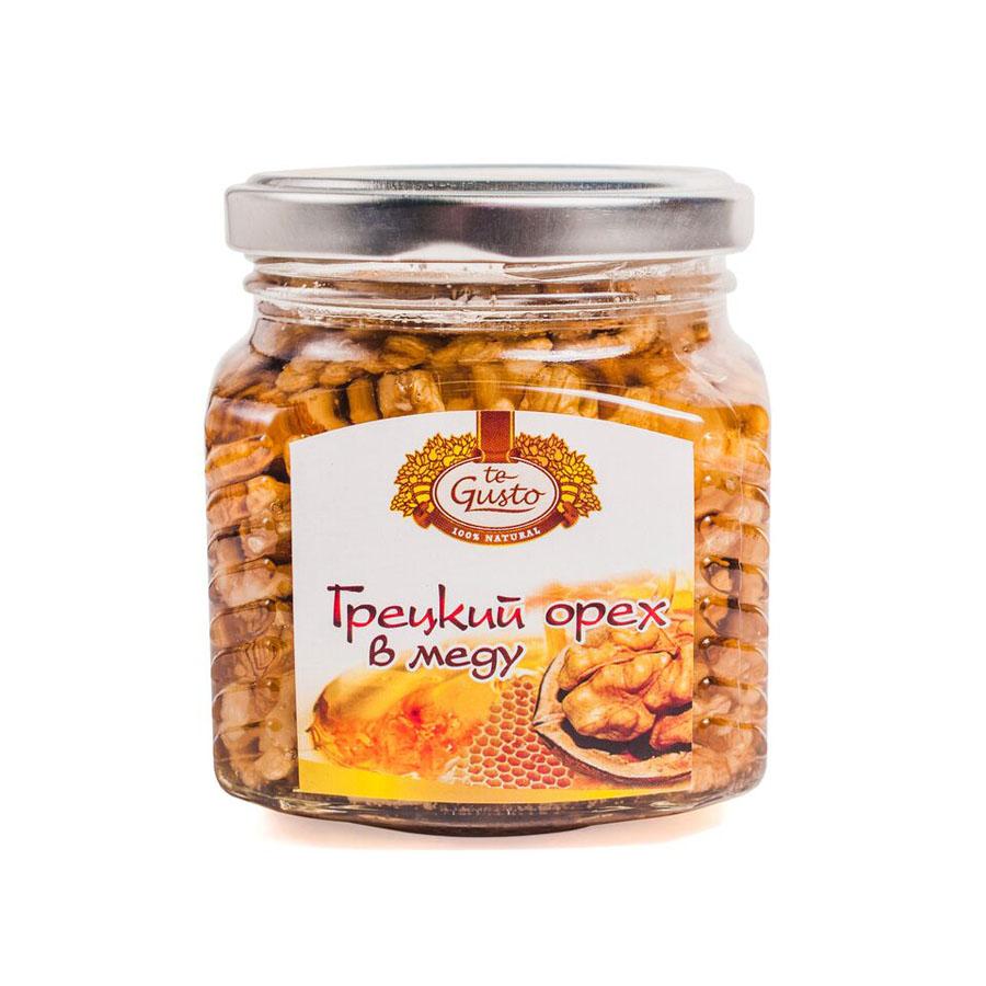 te Gusto Грецкие орехи в меду, 300 г4657155301191Грецкий орех в меду - натуральный продукт, приготовленный из высококачественных сортов мёда и ядра грецкого ореха. Фармакологическое действие: Грецкий орех в меду оказывает на организм комплексное воздействие, обусловленное действием мёда и ядра грецкого ореха. Грецкий орех содержит витамины А, Е, С, В1, В2, В6, В12, микроэлементы, легко усваиваемые белки, растительные жиры. Богатый состав мёда определяет широкий спектр его фармакологических эффектов - антибактериального, противовирусного, противовоспалительного, иммуностимулирующего и других. Грецкий орех в меду ликвидирует недостаток витаминов и микроэлементов, повышает сопротивляемость организма, регулирует обменные процессы. Укрепляет сосуды, обладает антисклеротическим и антианемическим действием, нормализует состав крови. Благотворно влияет на работу центральной и периферической нервной системы.