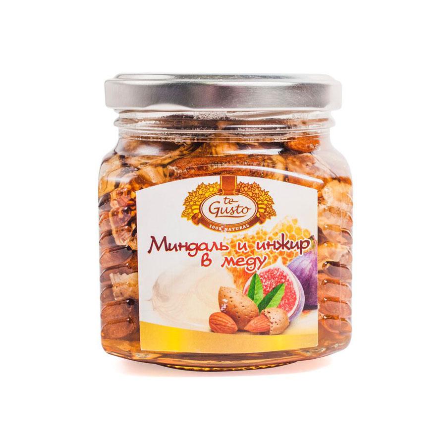te Gusto Миндаль и инжир в меду, 300 г4657155301634Миндаль и инжир в меду TE GUSTO В состав входят только натуральные компоненты: горный мед , ядра миндаля и инжир. Такой продукт рекомендуется употреблять как взрослым, так и детям. Продукт не содержит химических добавок и красителей. Такой мед хорошо употреблять в период вирусных заболеваний и простуд, так как орехи, инжир и мед в сочетании оказывают положительное действие на иммунную систему человека. Продукт содержит множество витаминов и микроэлементов, что способствует хорошему пищеварению, работе сердца и мозга. Изделие имеет приятный вкус и насыщенный аромат, который никого не оставит равнодушным.