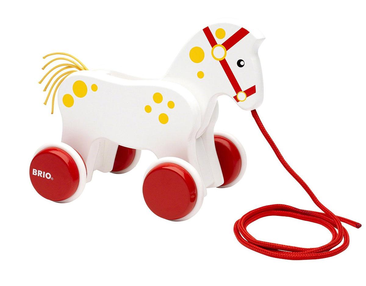 Brio Игрушка-каталка Лошадка30216Игрушка-каталка Brio Лошадка непременно понравится вашему малышу, подойдет для игры, как дома, так и на свежем воздухе. Игрушка выполнена из дерева с использованием нетоксичных красок в виде маленькой лошадки. Благодаря текстильному шнурку и четырем колесикам малыш сможет катать игрушку. Во время движения лошадь двигает головой. Игрушка-каталка Brio Лошадка развивает пространственное мышление, цветовое восприятие, тактильные ощущения, ловкость и координацию движений.