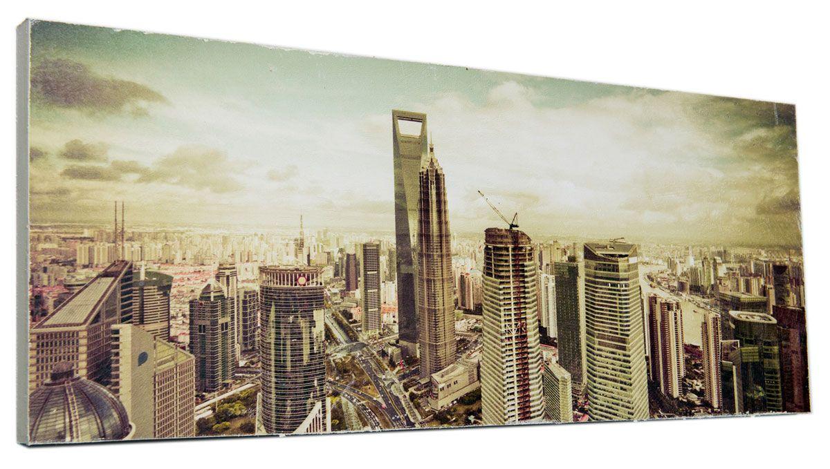 Картина Mister Poster Величественные высотки, 60 х 24 см0342-24-60Картина Mister Poster - это высококачественная репродукция на деревянной раме. Лицевая поверхность имитирует штукатурку или натуральный холст, края окрашены вручную специальным декоративным составом. Современные технологии, уникальное оборудование и оригинальные чернила, используемые при изготовлении, делают постер устойчивым к выцветанию, а также гарантируют стойкость к воздействию негативных внешних факторов. Интерьер дома и офиса, в котором находится человек, в значительной степени влияет на его настроение и работоспособность. Правильное оформление интерьера создает благоприятный психологический климат, улучшает настроение и мотивирует. Добавьте «красок» в ваш интерьер и, возможно, в вашу жизнь.