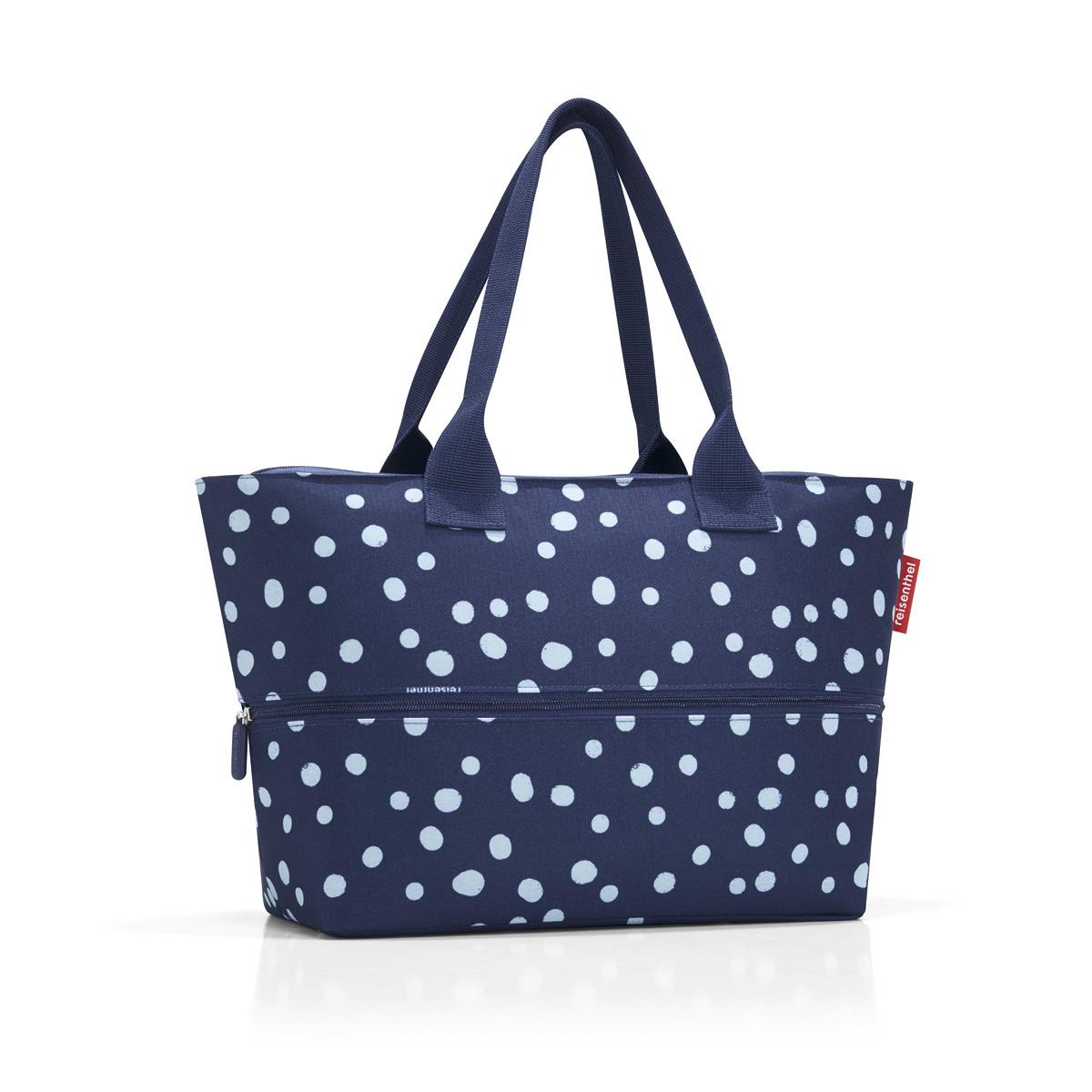 Сумка-шоппер женская Reisenthel Shopper E1 spots navy, цвет: темно-синий, белый. RJ4044RJ4044Удобная сумка для шоппинга и путешествий, способная изменять свой размер. - в основе конструкции - специальная молния, расстегнув которую вы увеличиваете вместимость сумки с 12 до 18 литров; - внутри предусмотрен карман на молнии для мелочей; - две удобные ручки для ношения на плече.
