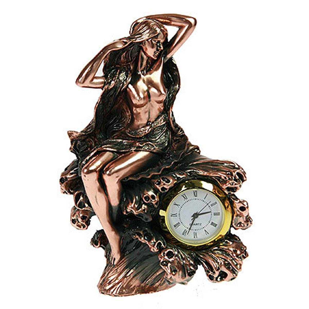 Часы настольные Русские Подарки Девушка. 127566127566Настольные кварцевые часы Русские Подарки Девушка изготовлены из полистоуна. Часы имеют три стрелки - часовую, минутную и секундную. Изящные часы красиво и оригинально оформят интерьер дома или рабочий стол в офисе. Также часы могут стать уникальным, полезным подарком для родственников, коллег, знакомых и близких. Часы работают от батареек типа АА (в комплект не входят).