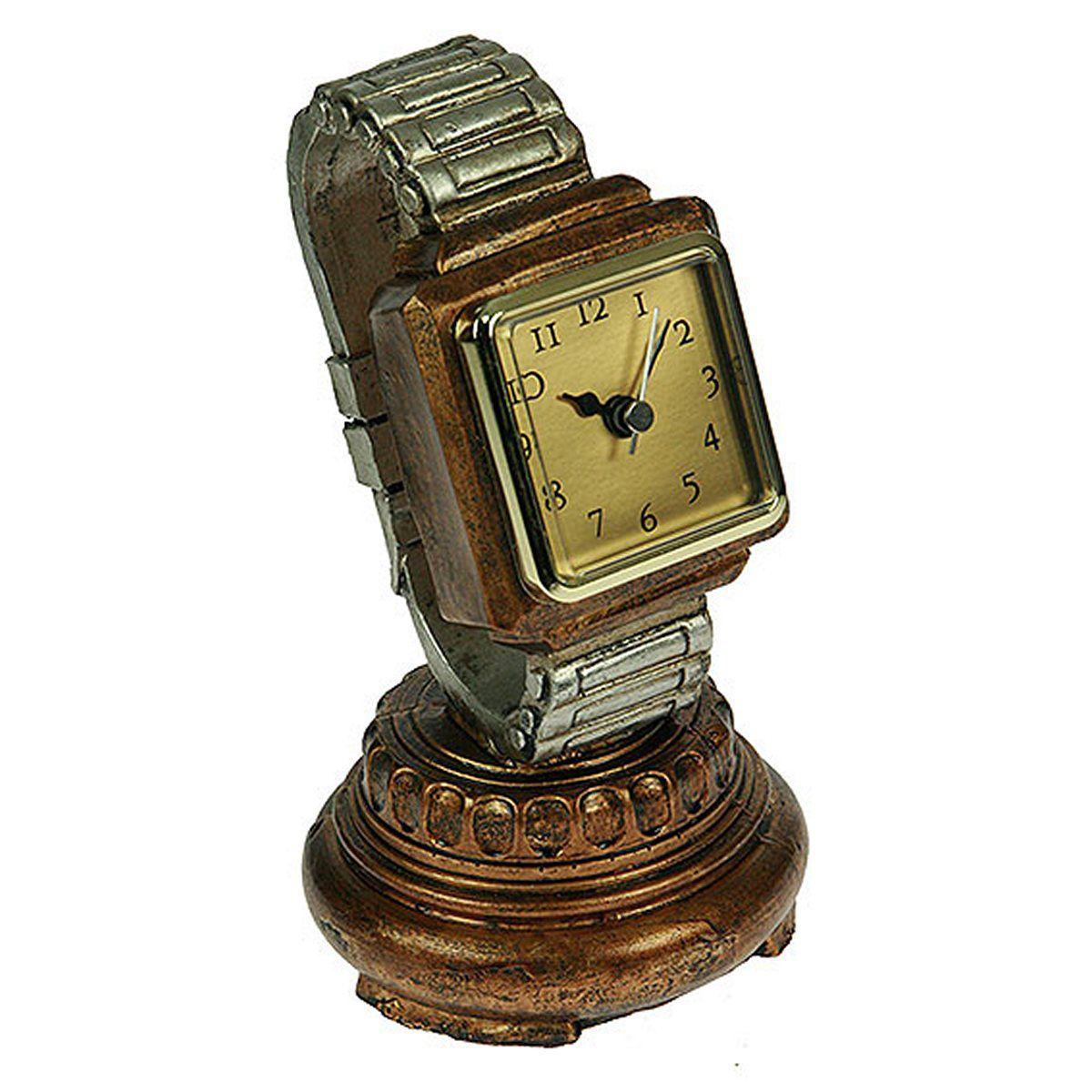 Часы настольные Русские Подарки, 20 х 10 см. 2851328513Настольные кварцевые часы Русские Подарки изготовлены из полистоуна, циферблат защищен стеклом. Часы имеют три стрелки - часовую, минутную и секундную. Такие часы красиво и необычно оформят интерьер дома или рабочий стол в офисе. Также часы могут стать уникальным, полезным подарком для родственников, коллег, знакомых и близких. Часы работают от батареек типа АА (в комплект не входят).