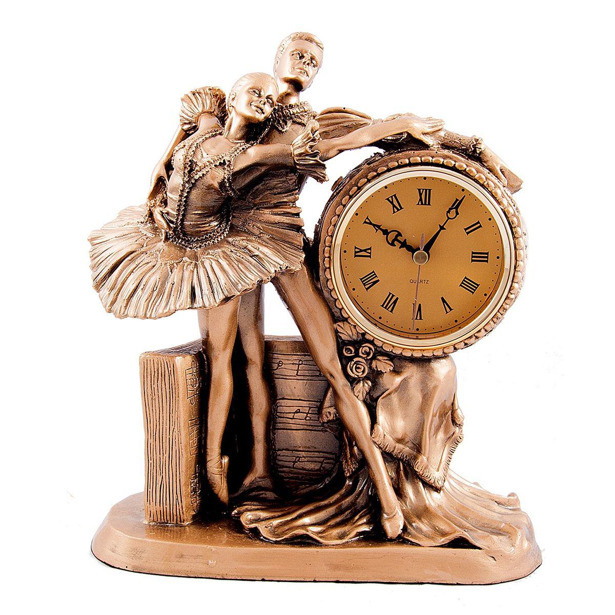 Часы настольные Русские Подарки Балет, 23 х 12 х 26 см. 5937359373Настольные кварцевые часы Русские Подарки Балет изготовлены из полистоуна, циферблат защищен стеклом. Часы имеют три стрелки - часовую, минутную и секундную. Изящные часы красиво и оригинально оформят интерьер дома или рабочий стол в офисе. Также часы могут стать уникальным, полезным подарком для родственников, коллег, знакомых и близких. Часы работают от батареек типа АА (в комплект не входят).