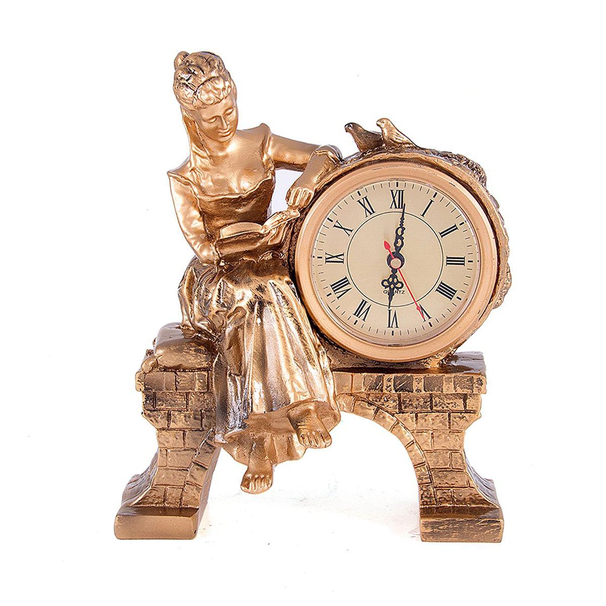 Часы настольные Русские Подарки Дама с книгой, 25 х 20 см. 5941759417Настольные кварцевые часы Русские Подарки Дама с книгой изготовлены из полистоуна. Корпус оформлен фигуркой девушки, читающей книгу. Часы имеют три стрелки - часовую, минутную и секундную. Изящные часы украсят интерьер дома или рабочий стол в офисе. Также часы могут стать уникальным, полезным подарком для родственников, коллег, знакомых и близких. Часы работают от батареек типа АА (в комплект не входят).