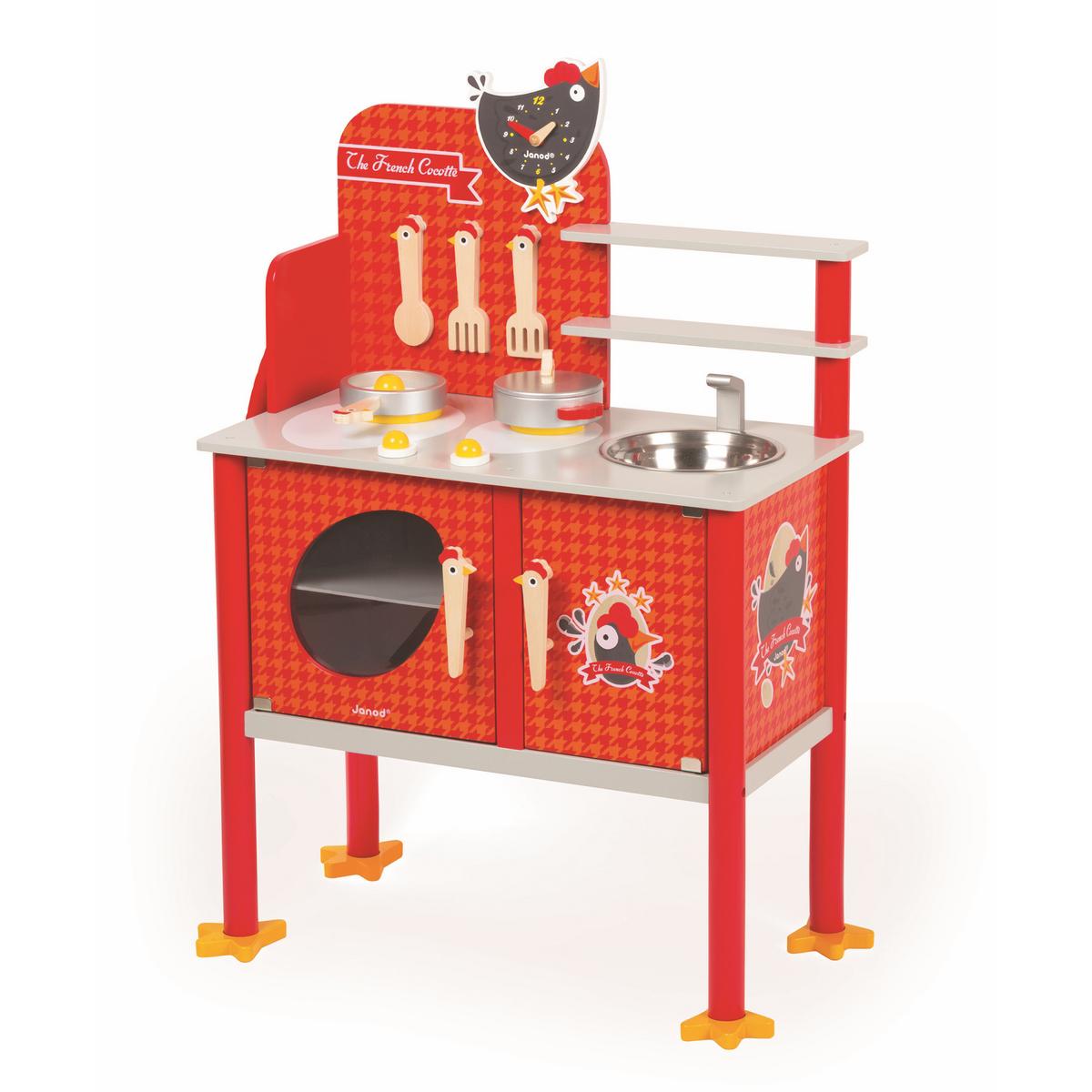 Janod Игрушечная кухня КурочкаJ06543Игрушечная кухня Janod Курочка - это очень реалистичное место, где ваш ребенок сможет примерить на себя роль повара или домохозяйки, придумать что-то новое или импровизировать. В наборе все продумано до мелочей. Кухня представляет из себя комод на забавных куриных ножках с шкафчиком, полками и подвесами, плитой и мойкой с краном. На ней помещаются все кухонные приборы.Также в набор входят игрушечные часы в виде курочки со стрелками, по которым ваш малыш научиться определять время и вести счет. Все элементы набора выполнены из прочного дерева и покрыты безвредной краской, они совершенно безопасны для ребенка. Ваш ребенок будет в восторге от такого подарка! В процессе игры с таким набором стимулируется мозговая активность, развиваются моторика рук, пространственное мышление и творческие способности ребенка.
