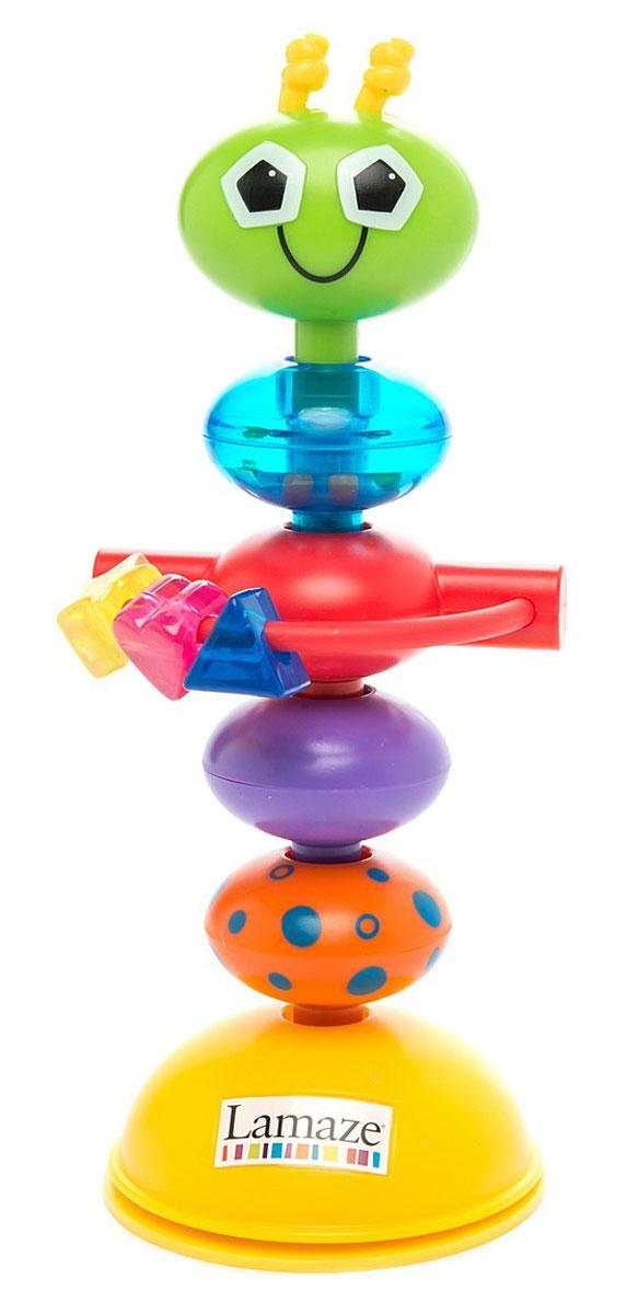 Tomy Развивающая игрушка с присоской Деловой жучокLC27224Развивающая игрушка Tomy Деловой жучок приведет малыша в восторг. Изготовлена из прочного и безопасного материала, а ее размер подходит для маленьких детских ручек. Игрушка удобно крепится к любой ровной поверхности с помощью присоски. Например, на столик для кормления - и тогда малыш не заскучает за едой. Когда малыш потянет игрушку, она забавно изогнется и издаст свойственные погремушке звуки. Все элементы игрушки поворачиваются, мягкие усики на голове жучка можно погрызть. На кольце подвешены цветные бусины, маленькие колечки, которые привлекут внимание ребенка и познакомят его с цветами и формами. Игра с забавным жучком способствуют развитию мелкой моторики, слуха и зрения.