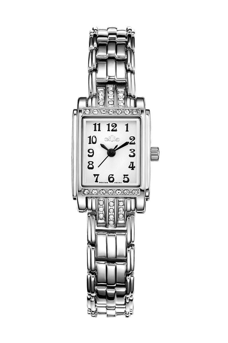 Часы наручные женские Mikhail Moskvin Каприз, цвет: серебристый. 576-6-1576-6-1Строгость линейных очертаний модели коллекции «Каприз» наполняют образ элегантностью и энергетической эстетикой. Современный рельефный дизайн часов добавляет присущую им женственность. Корпус-браслет, шириной 18 мм покрыт по современным технологиям напылением ионами стали и инкрустирован дорожками сияющих стразов. Циферблат хорошо читается за счет классического сочетания черных арабских цифр и стрелок на белом фоне. Угличские часовщики комплектуют часы надежным кварцевым механизмом производства фирмы Seiko Epson (Япония). Срок службы элемента питания 2 года. Модель оснащена минеральным, устойчивым к царапинам, стеклом и гипоаллергенной стальной задней крышкой.