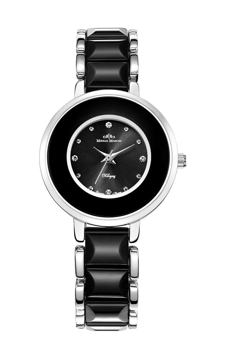 Часы наручные женские Mikhail Moskvin Каприз, цвет: черный. 1205A12B11205A12B1Взяв за основу благородное сочетание серебристого и черного покрытия, проектировщики создали модель, передающую дух коллекции женских часов «Каприз». Отличную считываемость показаний часов обеспечивают часовые индексы в виде сверкающих цирконов и круглых стальных знаков и острые стрелки. Часовая, минутная и секундная стрелки приходят в движение благодаря надежному кварцевому механизму производства фирмы Seiko Epson (Япония). Срок службы элемента питания 2 года. Задняя крышка изготовлена из гипоаллергенной нержавеющей стали. Серебристая пряжка на браслете гарантирует комфорт и надежность.