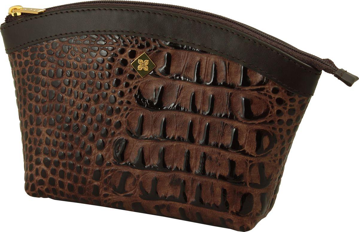 Косметичка Dimanche Loricata Brun, цвет: темно-коричневый. 475475_коричневыйКосметичка Dimanche выполнена из натуральной кожи с тиснением под рептилию и оформлена металлической пластинкой с логотипом бренда. Изделие закрывается с помощью застежки-молнии. Внутри расположено одно вместительное отделение.
