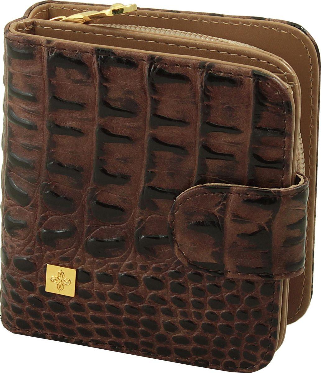 Кошелек женский Dimanche Loricata Brun, цвет: коричневый. 299/8299/8_коричневыйКошелек Dimanche Loricata Brun выполнен из натуральной кожи с оригинальным украшением. Модель состоит из двух отделений. В первом отделении, закрывающемся на хлястик с кнопкой, имеется 2 отделения для купюр и восемь кармашков для кредитных/визитных карт. Второе объемное отделение для мелочи закрывается на молнию, внутри имеется перегородка.