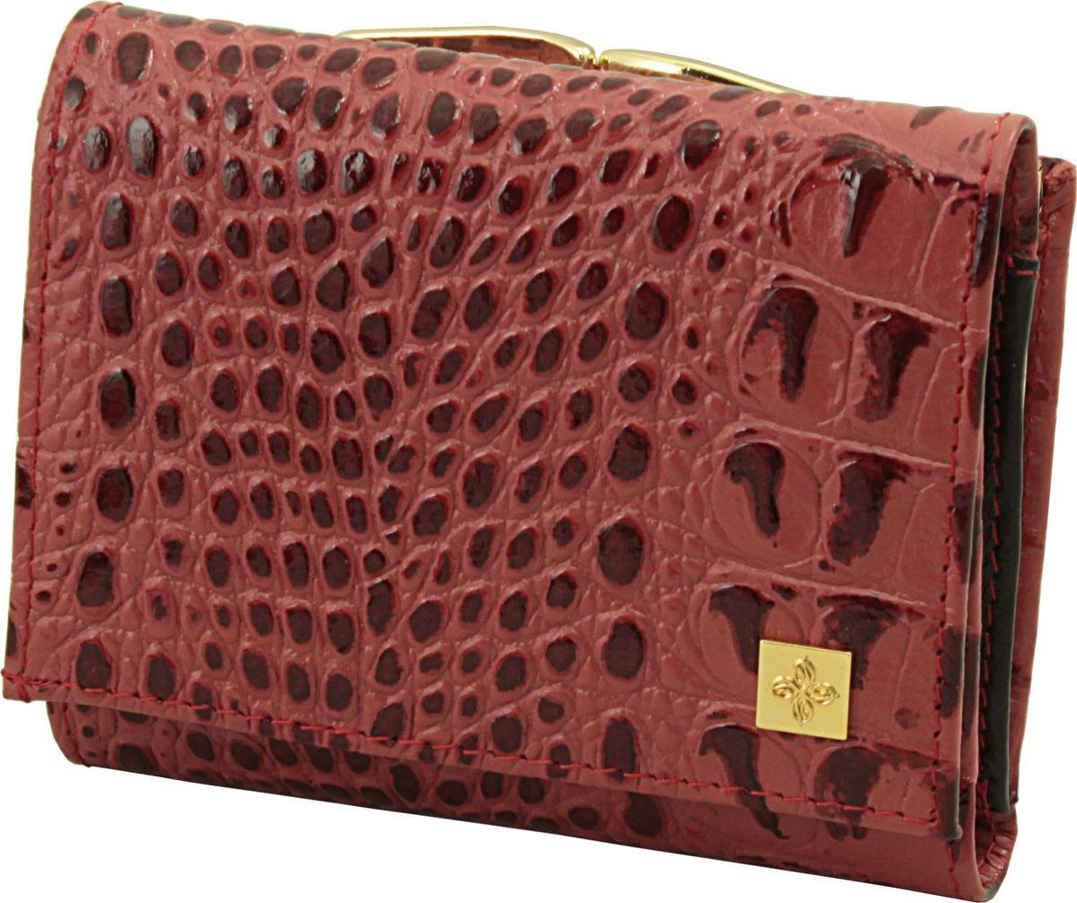 Кошелек женский Dimanche Loricata Rouge, цвет: красный. 127/8127/8_красныйКошелек из высококачественной гладкой кожи с оригинальным украшением. Состоит из двух отделений. Первое для мелочи закрывается на удобный металлический замочек. Во втором имеется 2 отделения для купюр с длинным кармашком на молнии, прозрачный кармашек для пропуска, 2 потайных кармашка и 8 карманов для визиток/кредиток. Закрывается на кнопку.