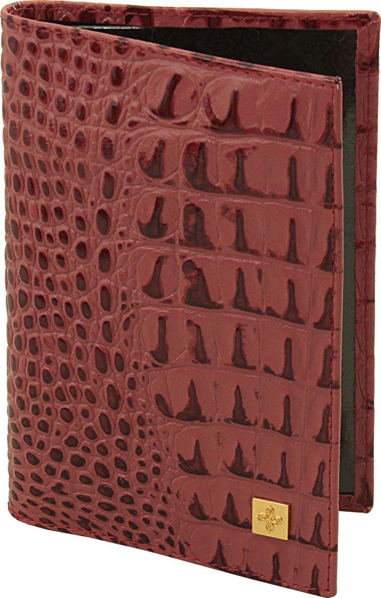 Обложка для паспорта женская Dimanche Loriсata Rouge, цвет: красный. 541/8541/8_красныйОбложка для паспорта Dimanche, выполненная из натуральной кожи, оформлена тиснением под рептилию и металлической пластинкой с логотипом бренда. Внутри расположено два кармана для фиксации документа. Обложка для паспорта сохранит внешний вид вашего документа и защитит от повреждений.