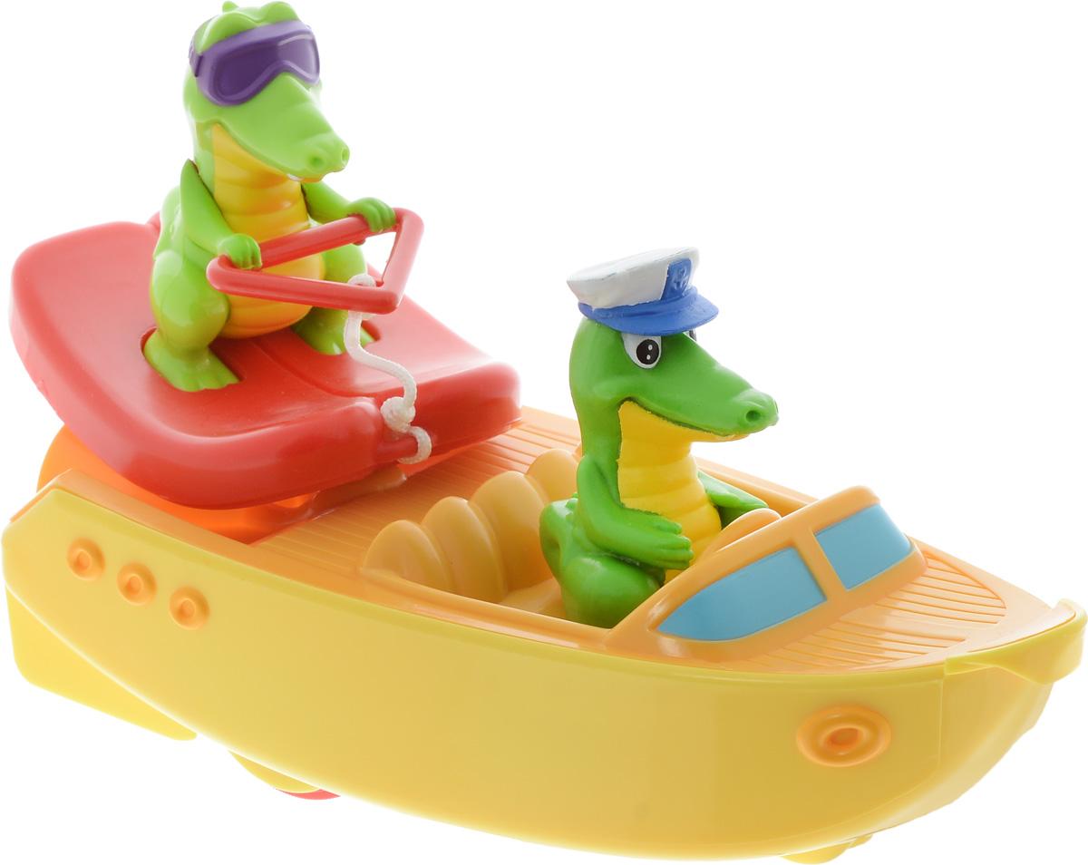 Tomy Игрушка для ванной Крокодил на лодкеE72358Прокати забавных крокодильчиков по волнам! Игрушка состоит из лодочки, в которой сидит крокодильчик-капитан, и крокодильчика-спортсмена на водных лыжах. Когда малыш вытянет фигурку крокодильчика на водных лыжах, который соединен с катером при помощи тонкого троса, моторчик на задней части лодочки заведётся, и катер отправится в плавание! При движении крокодильчик на лыжах потихоньку приближается к лодке, и, догнав её, оказывается в исходном положении. У катера также есть колёсики: малыш может возить лодочку по любой ровной поверхности.