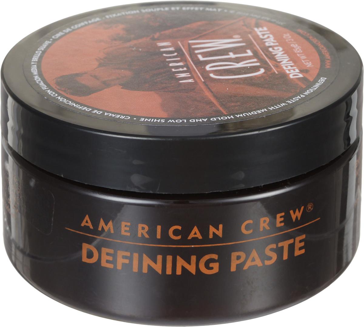 American Crew Паста для укладки волос Defining Paste 85 мл7209392000Паста от компании American Crew предназначена для средней фиксации прически, обеспечивая низкий уровень блеска волос. Глицерин делает волосы густыми и объемными. Ланолин придает сверхсильную фиксацию. А пчелиный воск увлажняет волосы, при этом обеспечивая стойкость прически. Удобная текстура, сочетаясь с легкостью применения, делает это укладывающее косметическое средство очень привлекательным для применения.