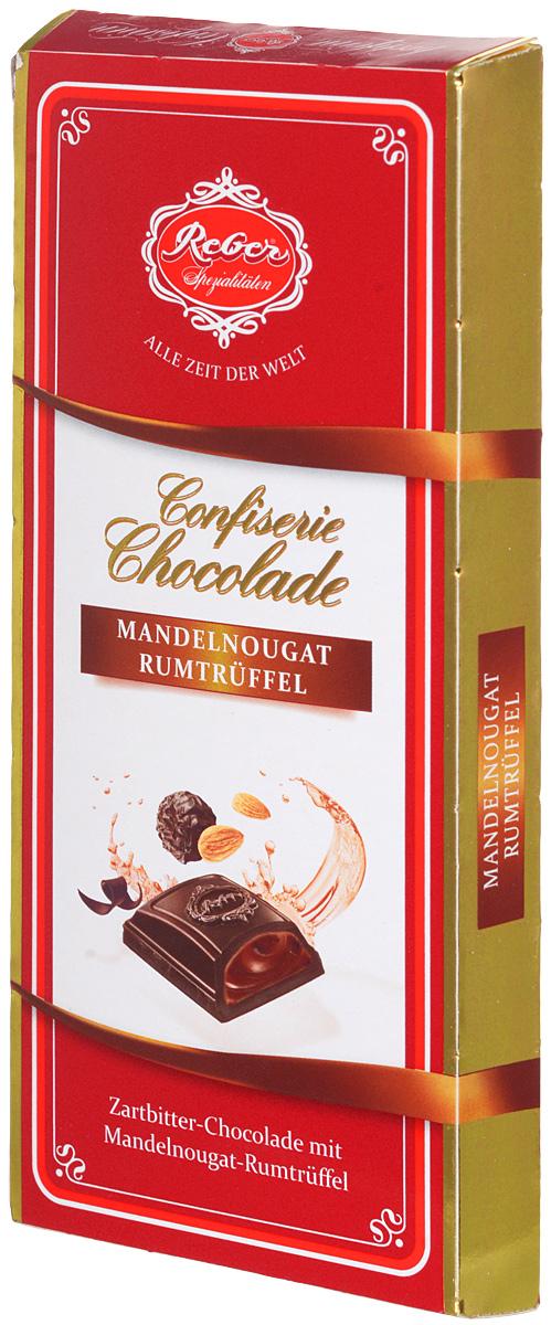 Reber горький шоколад Almond Praline-Rum Truffle с трюфельной начинкой из миндаля и рома, 100 г1410133/6Горький шоколад Reber Almond Praline-Rum Truffle с трюфельной начинкой из миндаля и рома.