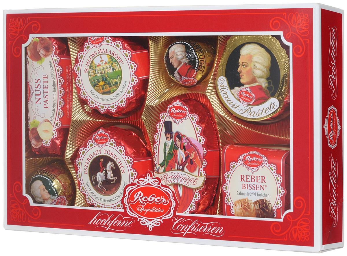 Reber Mozart подарочный набор шоколадных конфет, 285 г (коробка с окном)1410101/1Шоколадные конфеты от Reber Mozart - это не просто конфеты, это настоящие кондитерские шедевры. Впервые конфеты Ребер Моцарт были выпущены в 1890 году, через 100 лет после смерти великого Моцарта, и сразу завоевали невероятную популярность. Известные своим исключительным качеством, оригинальностью и изысканным дизайном, шоколадные деликатесы Reber в форме небольших подарочков - это настоящие драгоценности для ценителей.