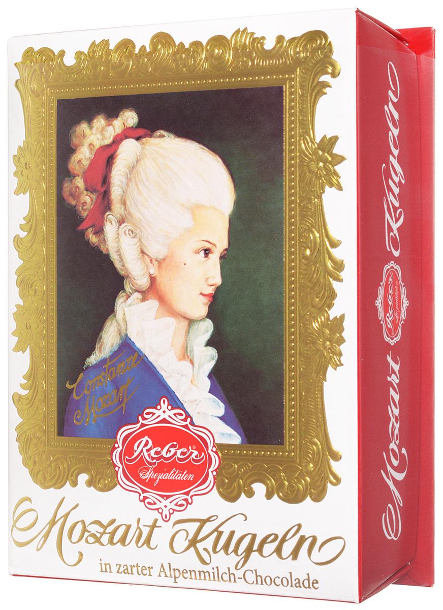 Reber Mozart Kugeln конфеты с молочным шоколадом, 120 г1410111/5Reber Mozart Kugeln - непревзойденные шоколадные конфеты, которые заполнены свежими зелеными фисташками, миндалем, фундуком, а сверху покрыты слоем настоящего молочного шоколада.