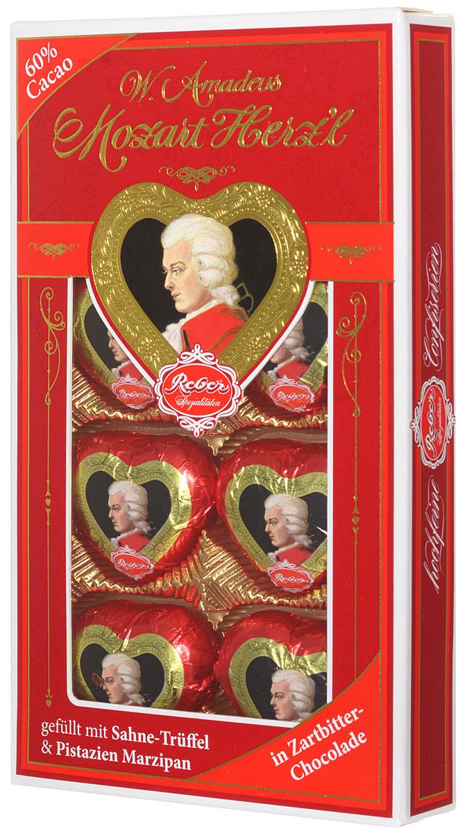 Reber Mozart Herz'l шоколадные конфеты, 80 г1410119Mozart Herz'l – великолепные конфеты, выполненные в форме сердечка. Состоят из зеленых фисташковых орехов расположенных в нежном сливочном трюфеле, а сверху покрыты отличным горьким шоколадом.