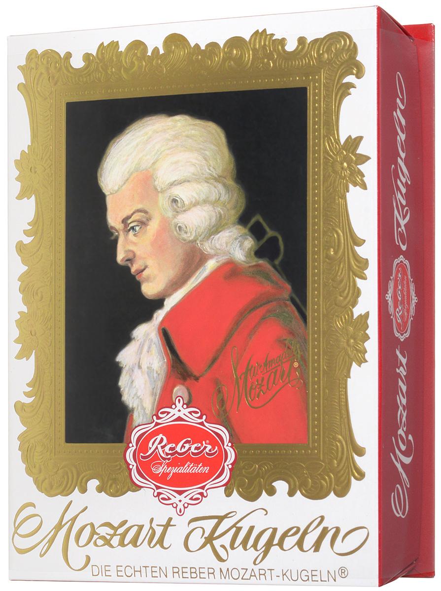 Reber Mozart Kugeln конфеты с горьким и молочным шоколадом, 240 г1410112Reber Mozart Kugeln - непревзойденные шоколадные конфеты, которые заполнены свежими зелеными фисташками, миндалем, фундуком, а сверху покрыты слоем горького и молочного шоколада.