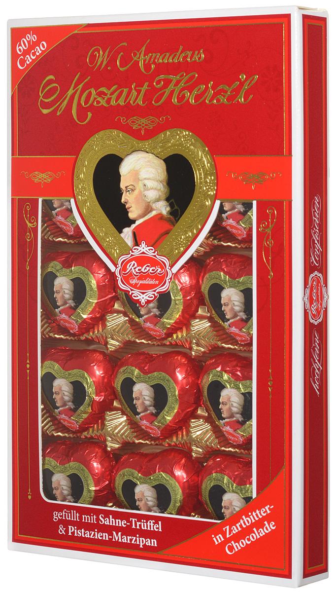 Reber Mozart Herz'l шоколадные конфеты, 150 г1410108Mozart Herzl - великолепные конфеты, выполненные в форме сердечка. Состоят из зеленых фисташковых орехов расположенных в нежном сливочном трюфеле, а сверху покрыты отличным горьким шоколадом.