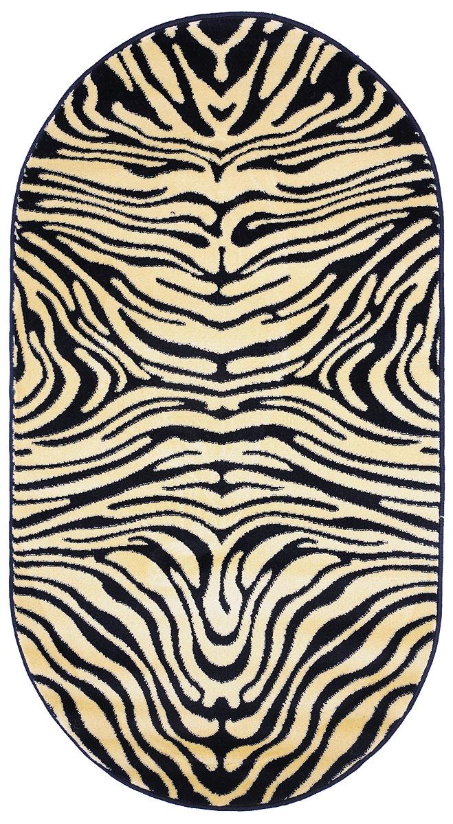 Ковер Kamalak Tekstil, овальный, 80 x 150 см. УК-0035УК-0035Ковер Kamalak Tekstil изготовлен из прочного синтетического материала heat-set, улучшенного варианта полипропилена (эта нить получается в результате его дополнительной обработки). Полипропилен износостоек, нетоксичен, не впитывает влагу, не провоцирует аллергию. Структура волокна в полипропиленовых коврах гладкая, поэтому грязь не будет въедаться и скапливаться на ворсе. Практичный и износоустойчивый ворс не истирается и не накапливает статическое электричество. Ковер обладает хорошими показателями теплостойкости и шумоизоляции. Оригинальный рисунок позволит гармонично оформить интерьер комнаты, гостиной или прихожей. За счет невысокого ворса ковер легко чистить. При надлежащем уходе синтетический ковер прослужит долго, не утратив ни яркости узора, ни блеска ворса, ни упругости. Самый простой способ избавить изделие от грязи - пропылесосить его с обеих сторон (лицевой и изнаночной). Влажная уборка с применением шампуней и моющих средств не противопоказана. ...