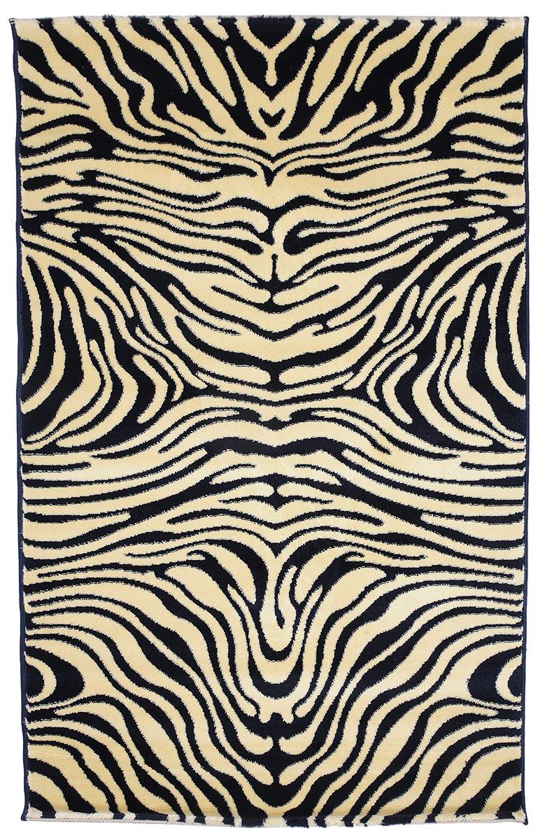 Ковер Kamalak Tekstil, прямоугольный, 100 x 150 см. УК-0032УК-0032Ковер Kamalak Tekstil изготовлен из прочного синтетического материала heat-set, улучшенного варианта полипропилена (эта нить получается в результате его дополнительной обработки). Полипропилен износостоек, нетоксичен, не впитывает влагу, не провоцирует аллергию. Структура волокна в полипропиленовых коврах гладкая, поэтому грязь не будет въедаться и скапливаться на ворсе. Практичный и износоустойчивый ворс не истирается и не накапливает статическое электричество. Ковер обладает хорошими показателями теплостойкости и шумоизоляции. Оригинальный рисунок позволит гармонично оформить интерьер комнаты, гостиной или прихожей. За счет невысокого ворса ковер легко чистить. При надлежащем уходе синтетический ковер прослужит долго, не утратив ни яркости узора, ни блеска ворса, ни упругости. Самый простой способ избавить изделие от грязи - пропылесосить его с обеих сторон (лицевой и изнаночной). Влажная уборка с применением шампуней и моющих средств не противопоказана. ...