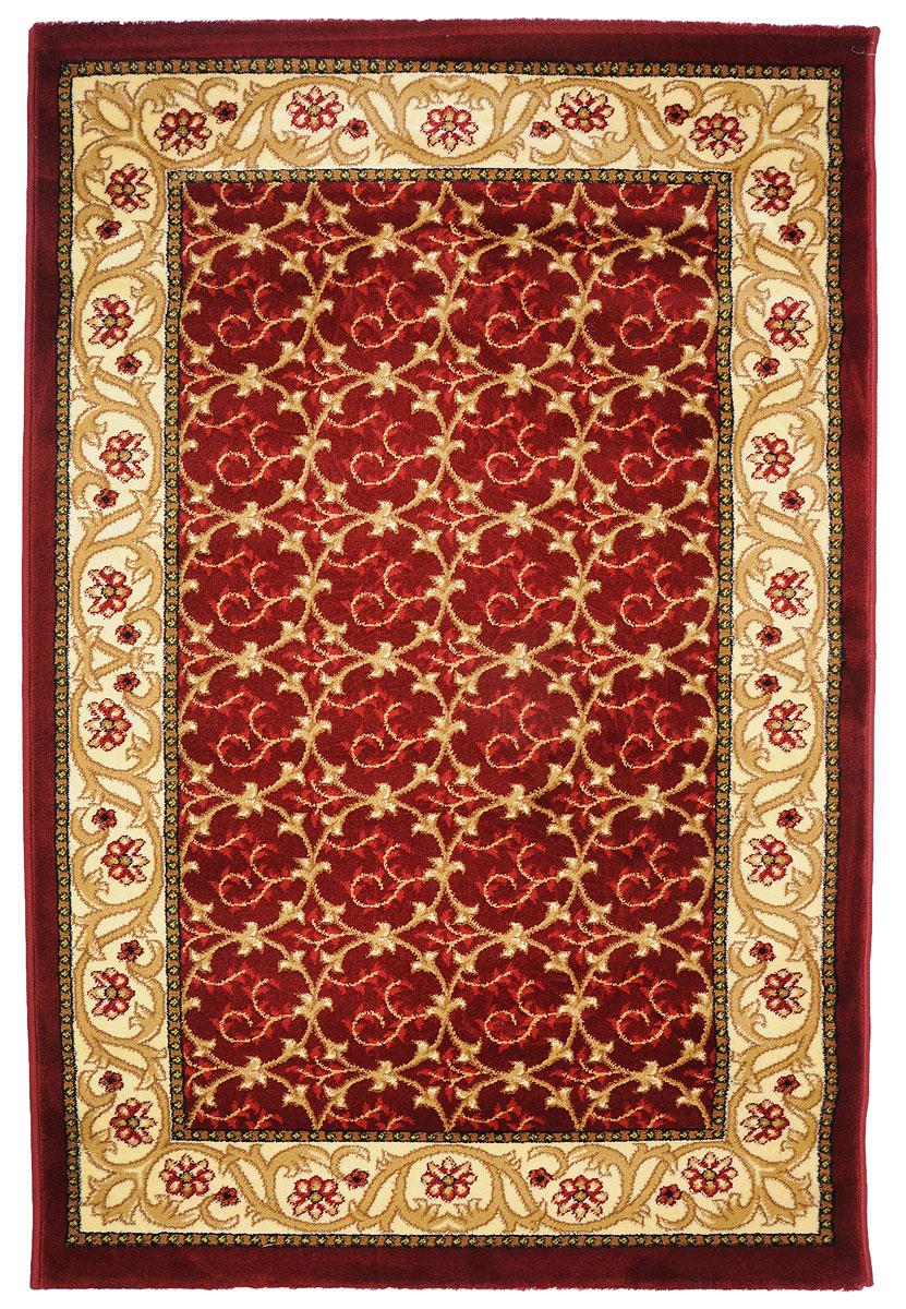 Ковер Kamalak Tekstil, прямоугольный, 100 x 150 см. УК-0221УК-0221Ковер Kamalak Tekstil изготовлен из прочного синтетического материала heat-set, улучшенного варианта полипропилена (эта нить получается в результате его дополнительной обработки). Полипропилен износостоек, нетоксичен, не впитывает влагу, не провоцирует аллергию. Структура волокна в полипропиленовых коврах гладкая, поэтому грязь не будет въедаться и скапливаться на ворсе. Практичный и износоустойчивый ворс не истирается и не накапливает статическое электричество. Ковер обладает хорошими показателями теплостойкости и шумоизоляции. Оригинальный рисунок позволит гармонично оформить интерьер комнаты, гостиной или прихожей. За счет невысокого ворса ковер легко чистить. При надлежащем уходе синтетический ковер прослужит долго, не утратив ни яркости узора, ни блеска ворса, ни упругости. Самый простой способ избавить изделие от грязи - пропылесосить его с обеих сторон (лицевой и изнаночной). Влажная уборка с применением шампуней и...